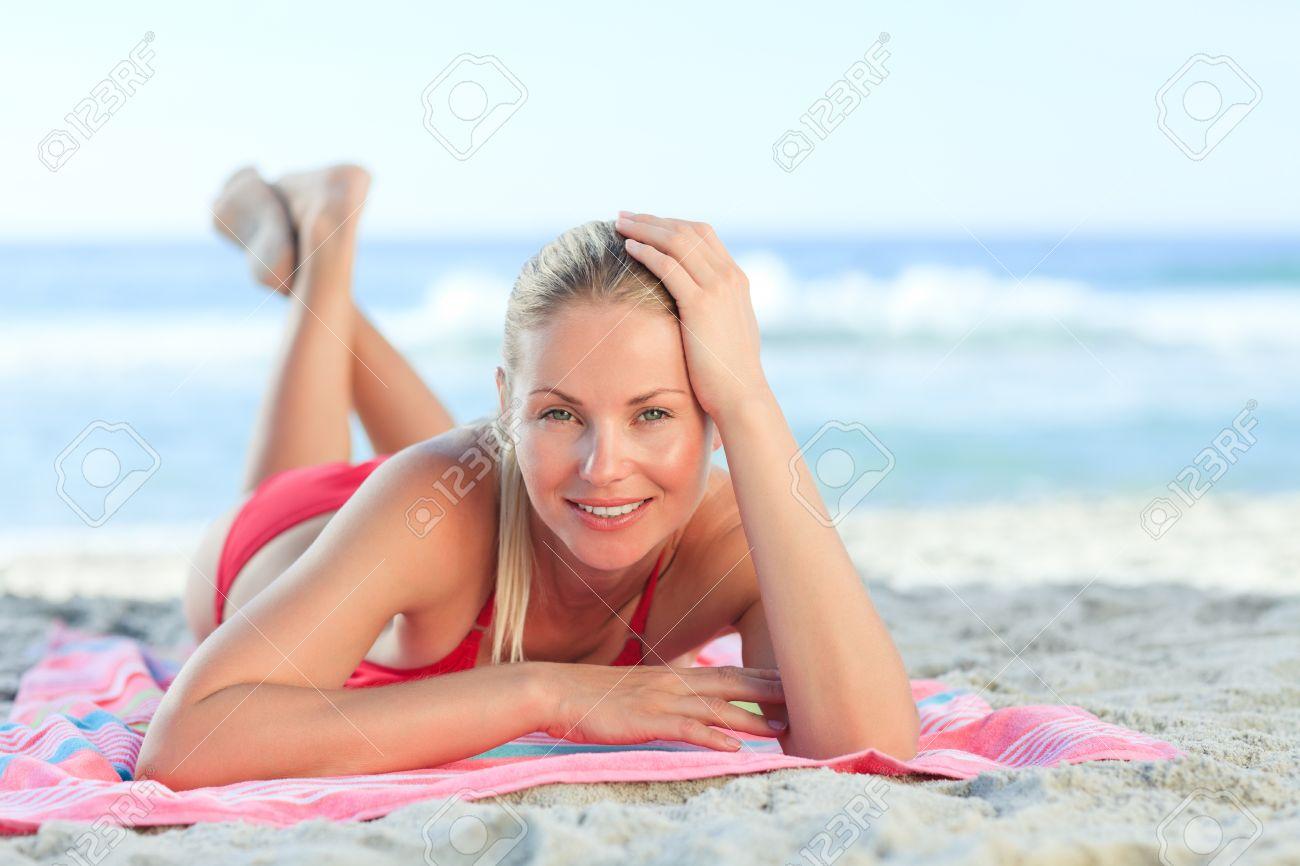 Beautiful woman lying down on the beach Stock Photo - 10183994