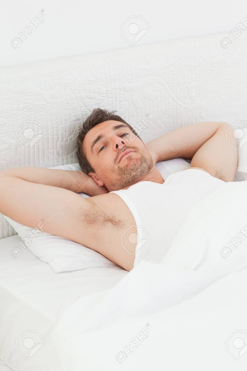 A relaxed man in his bed before waking up Stock Photo - 10196845