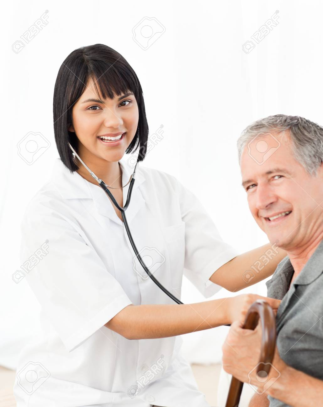 Nurse with her patient looking at the camera Stock Photo - 10196846