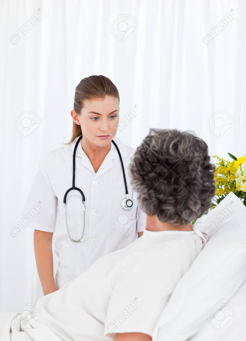 Mature woman talking with her nurse Stock Photo - 10195541