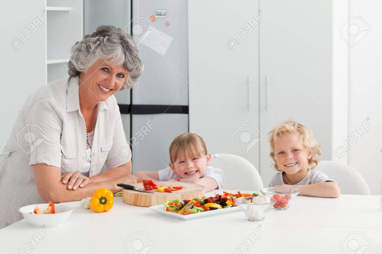 Children cooking with their grandmother at home Stock Photo - 10196735