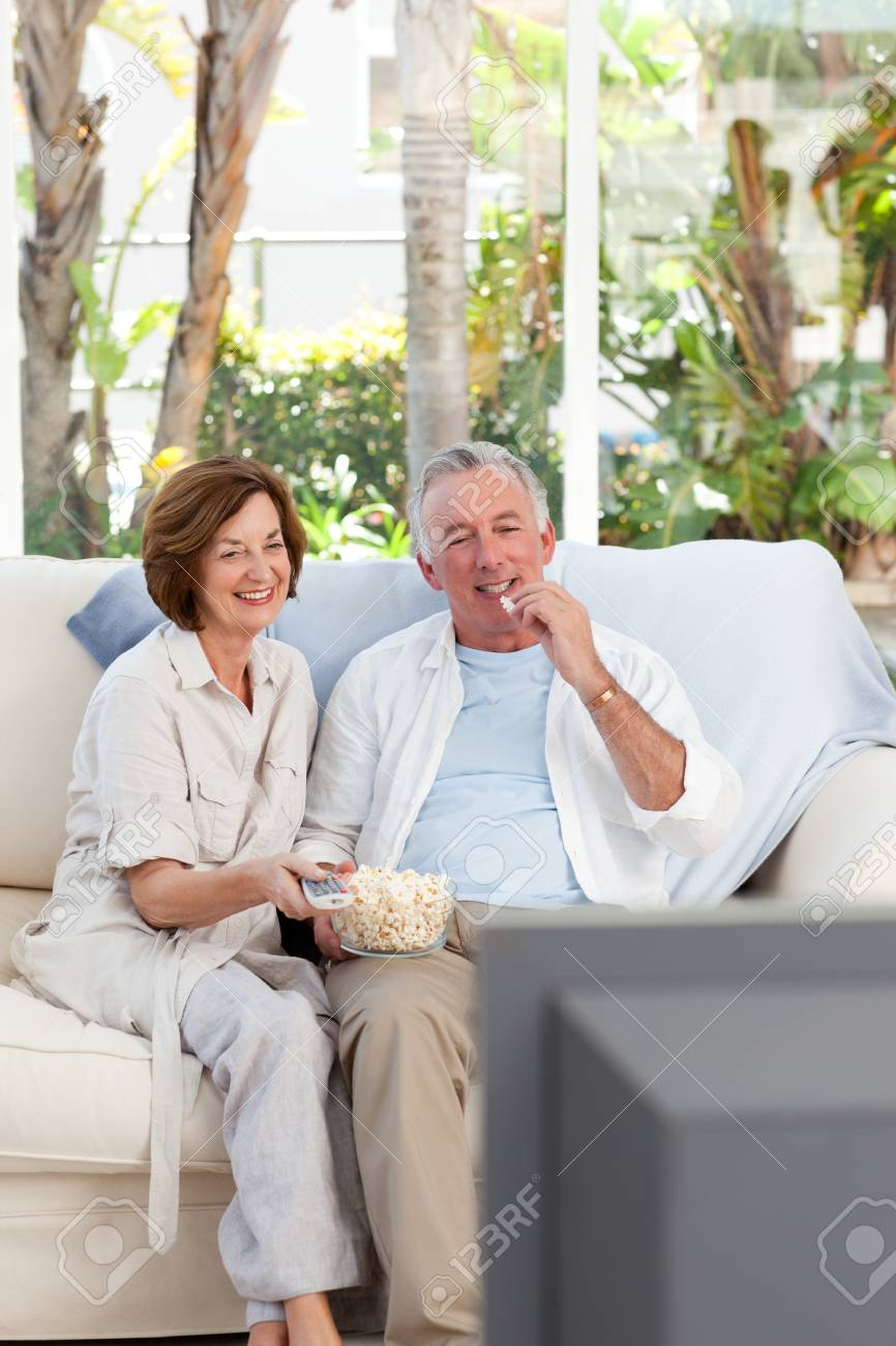 Seniors watching tv at home Stock Photo - 10197218