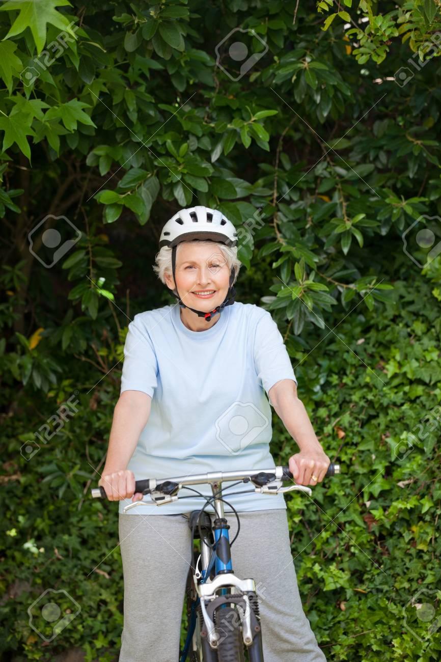 Mature woman mountain biking outside Stock Photo - 10190112