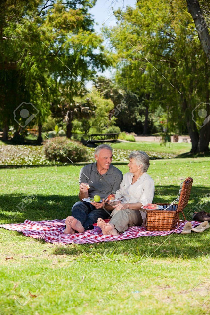Elderly couple  picnicking in the garden Stock Photo - 10197461