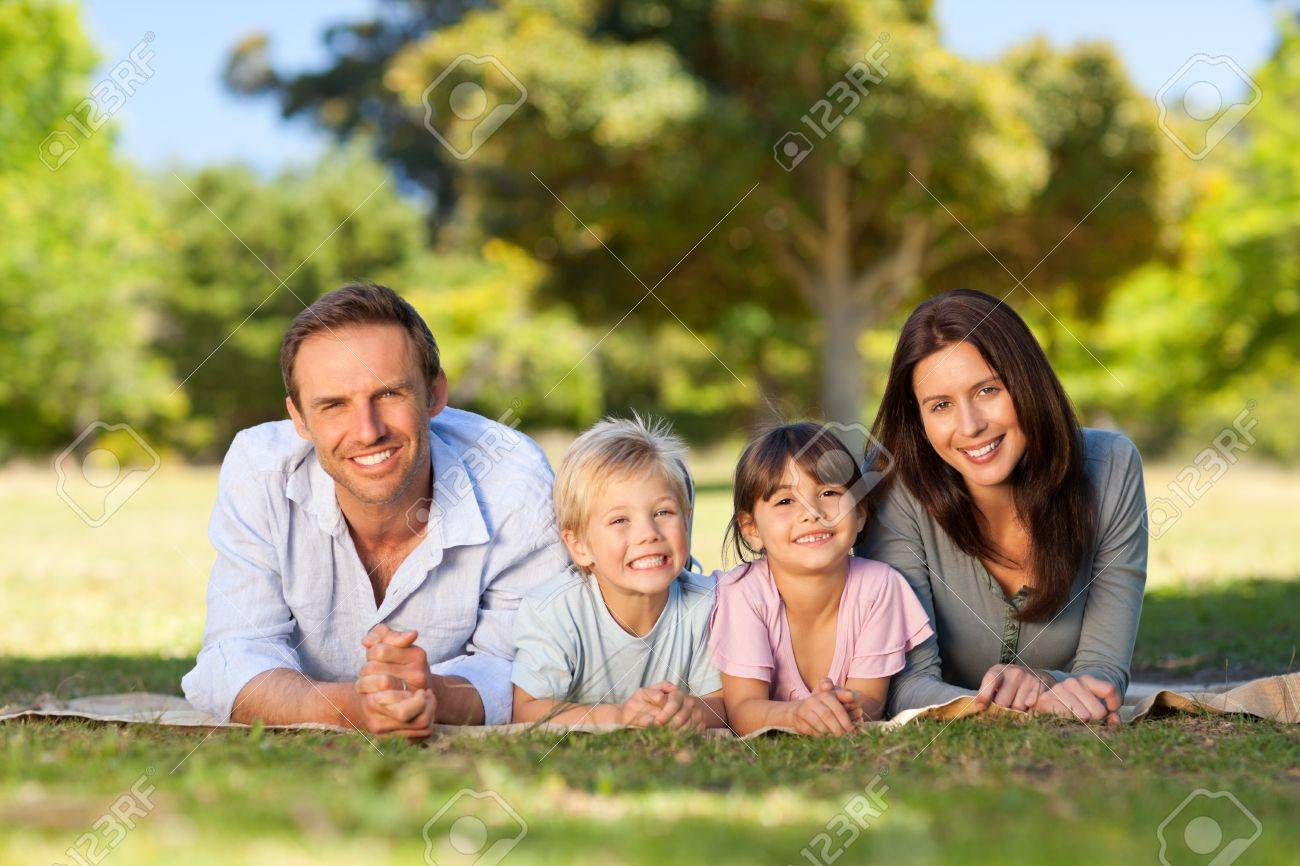 Family lying down in the park Stock Photo - 10197244