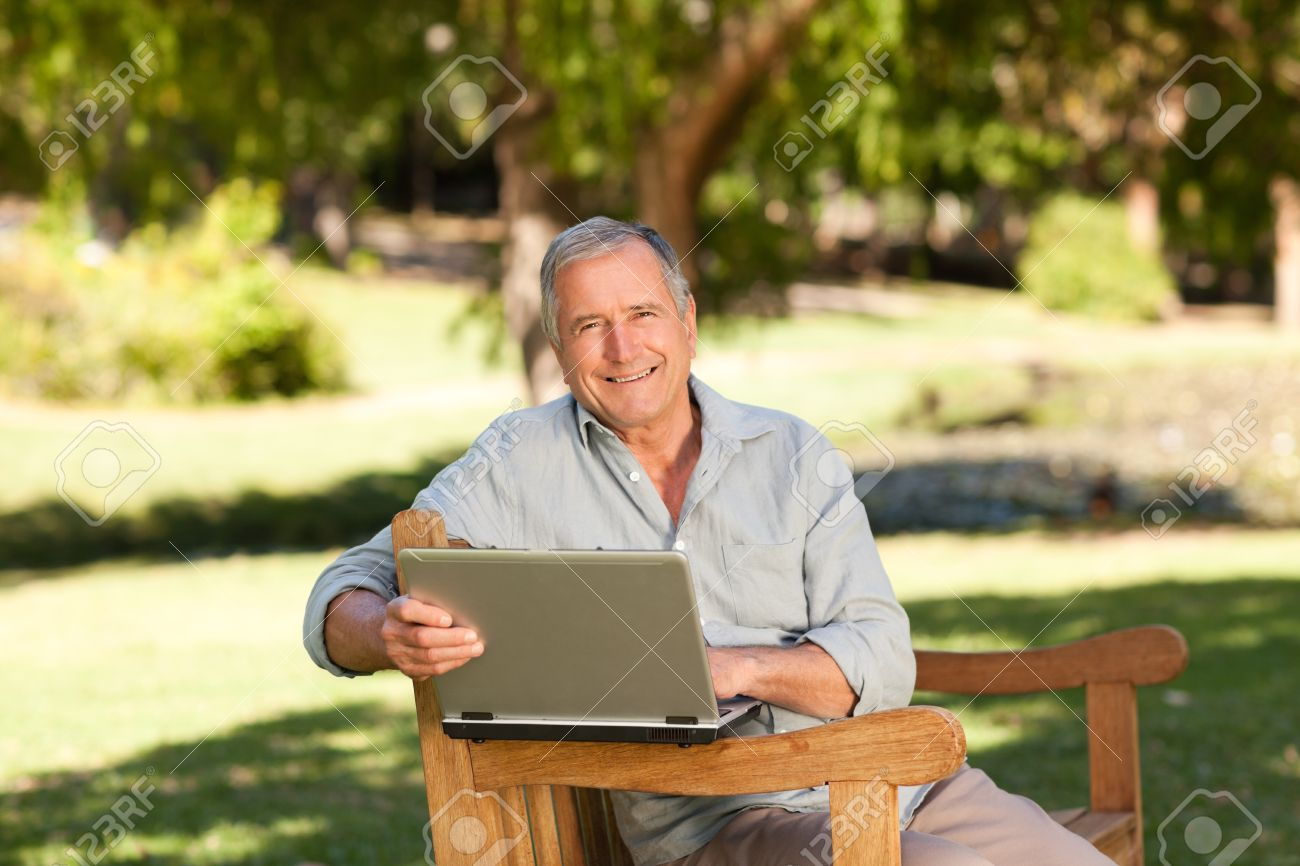 Retired man working on his laptop in the park Stock Photo - 10197154