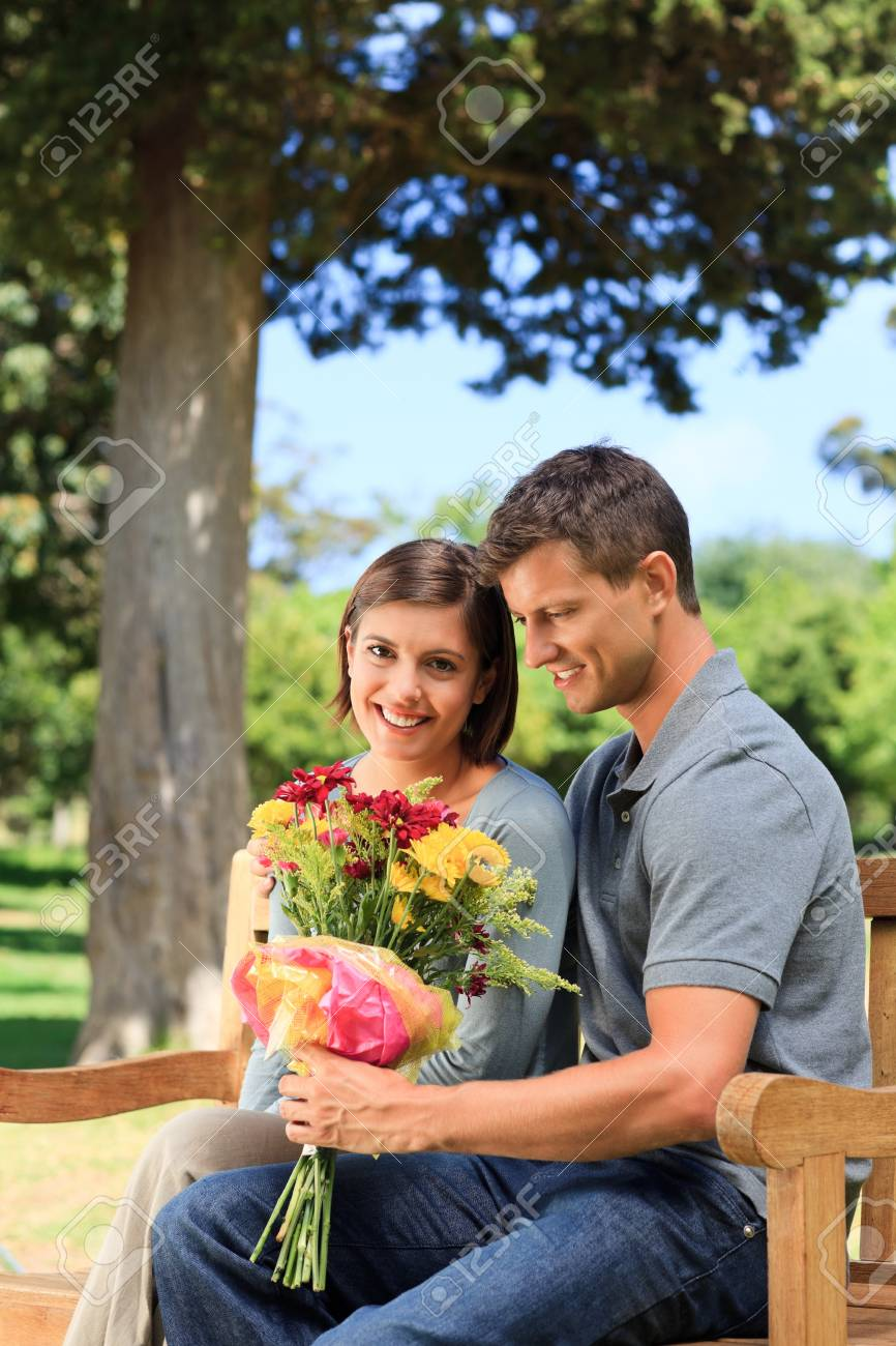 Man offering flowers to his girlfriend Stock Photo - 10197437