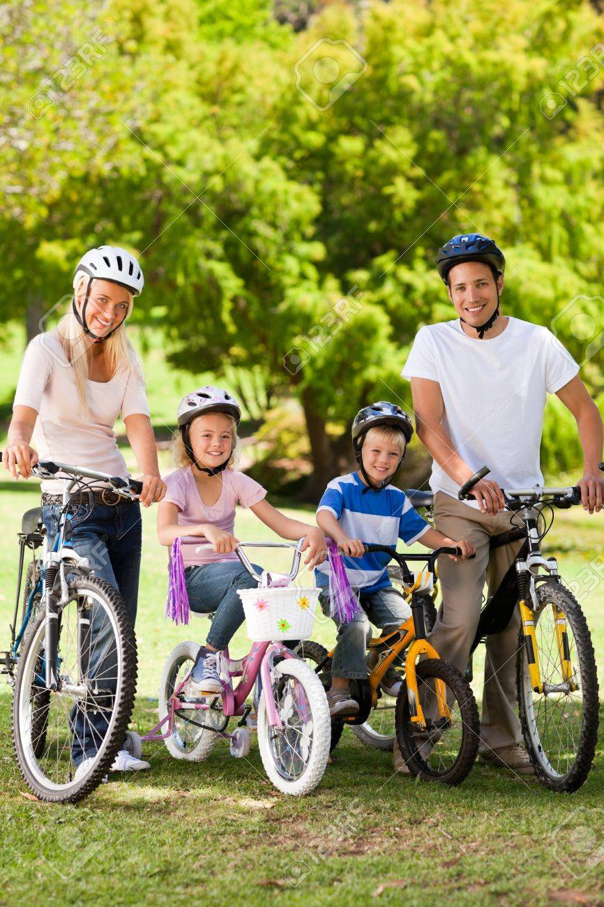 Family in the park with their bikes Stock Photo - 10197441