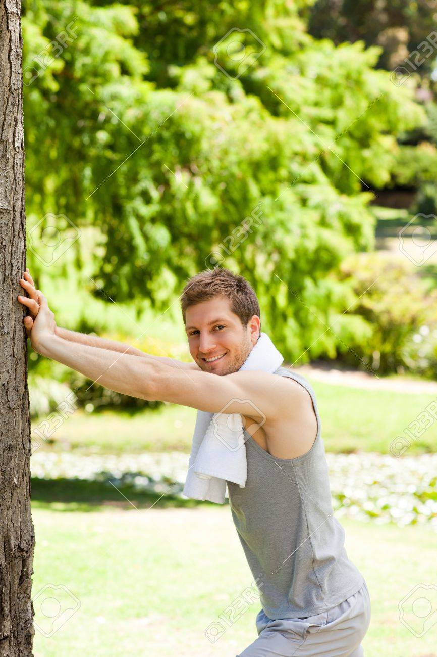Man doing his stretches in the park Stock Photo - 10185053