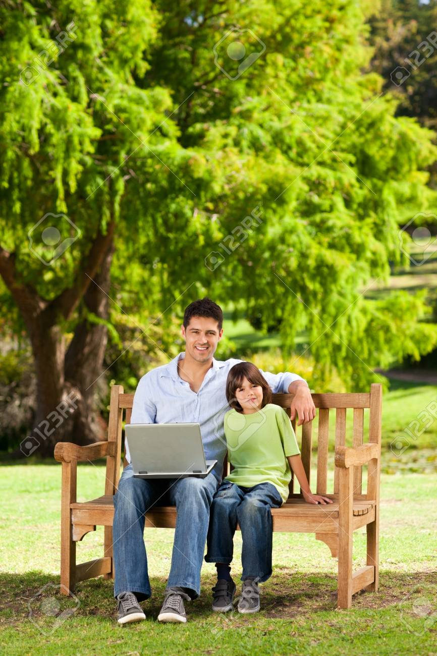 Father with his son looking at their laptop Stock Photo - 10195185