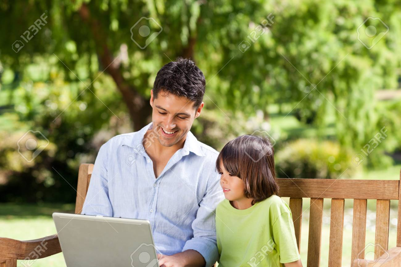 Father with his son looking at their laptop Stock Photo - 10194387