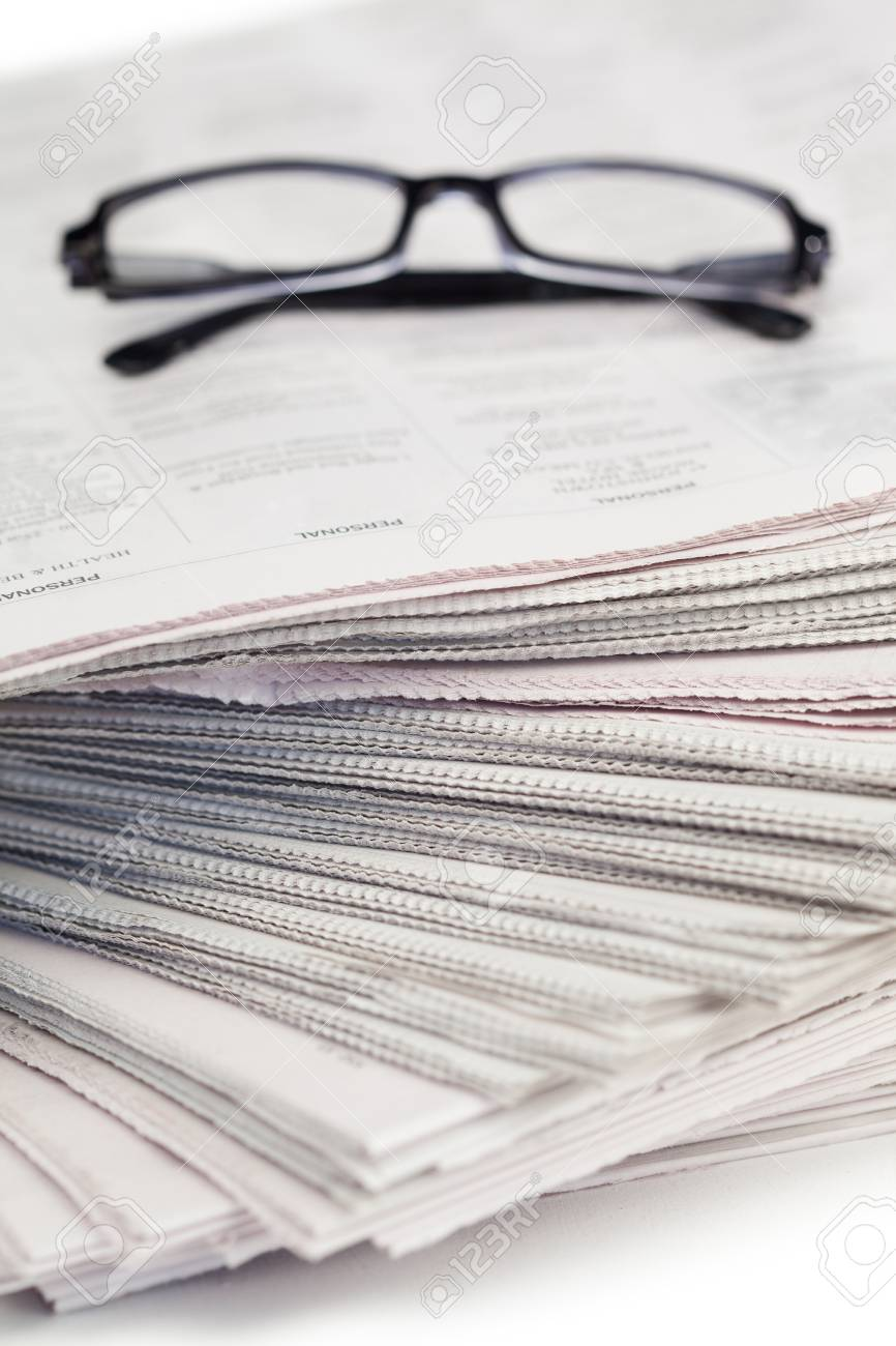 Newspapers and black glasses on a white a background Stock Photo - 10206049