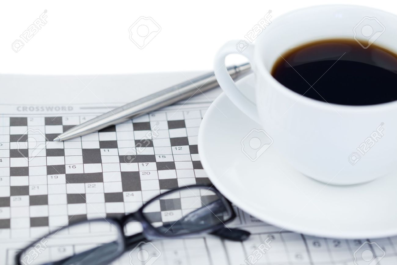 Newspapers and crossword puzzle on a white background Stock Photo - 10196247
