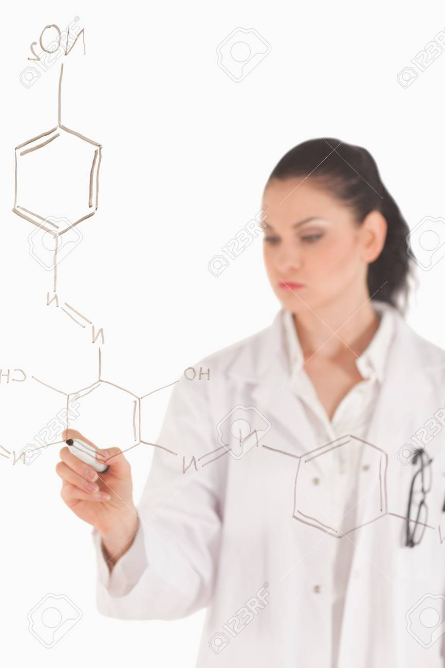 Dark-haired scientist writing a formula on a white board in a lab Stock Photo - 10194273