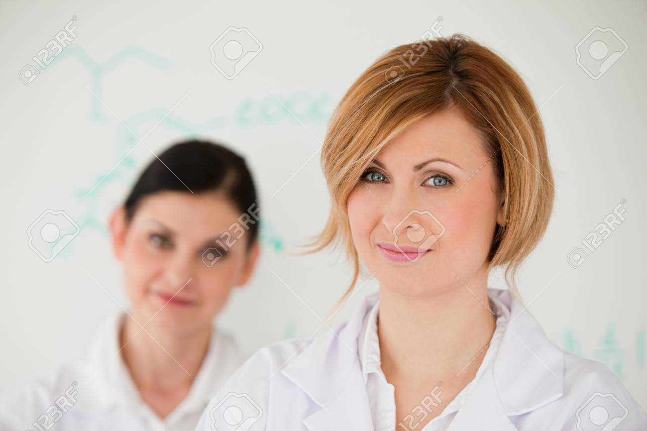 Attractive women in front of a white board in a lab Stock Photo - 10198913