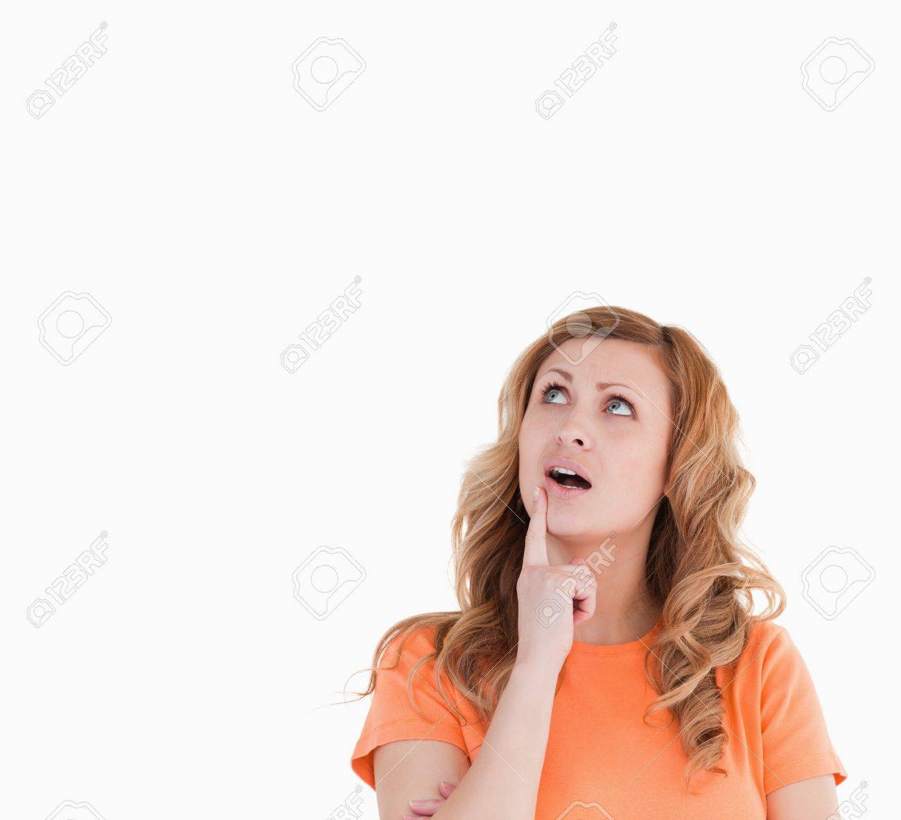 Cute woman thinking about something on a white background Stock Photo - 10194110