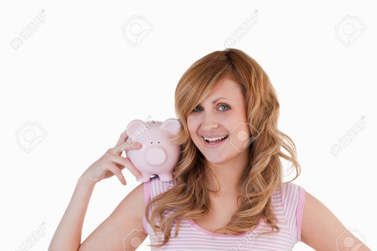 Blond-haired woman posing while holding her piggybank on a white background Stock Photo - 10195854