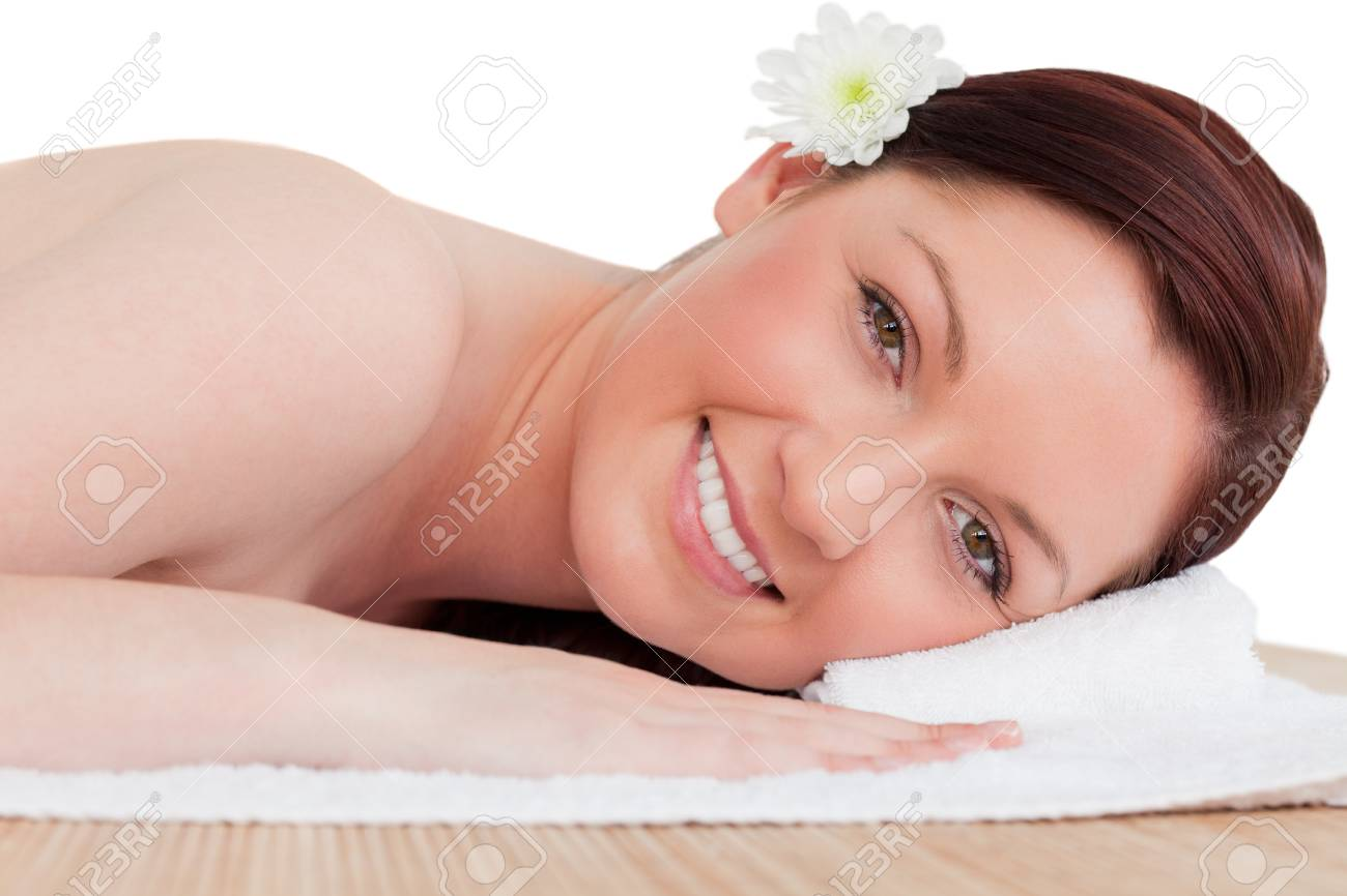 Portrait of a beautiful red-haired woman posing while relaxing in a spa centre Stock Photo - 10198852