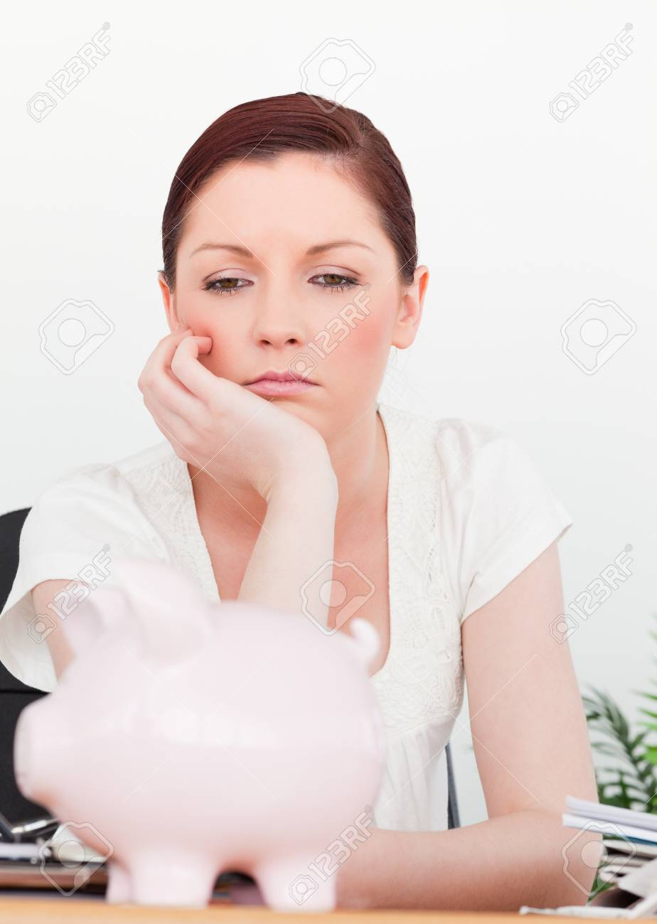 Young pensive female thinking while sitting in an office Stock Photo - 10198107