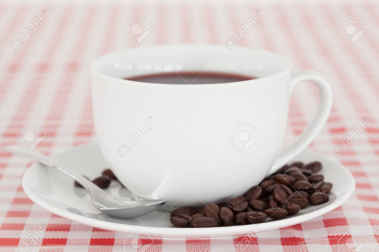 Coffee and beans on a tablecloth Stock Photo - 10198074