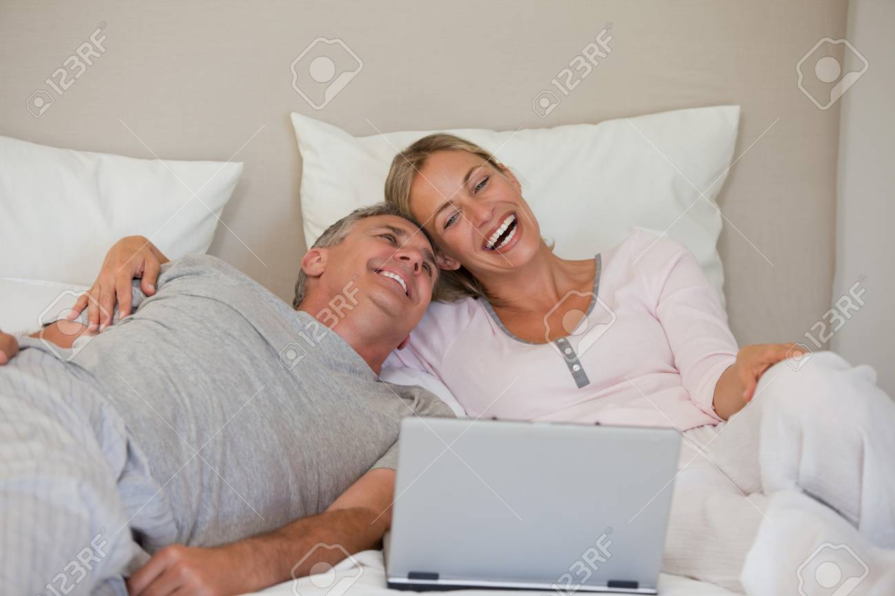 Lovely couple looking at their laptop Stock Photo - 10194651