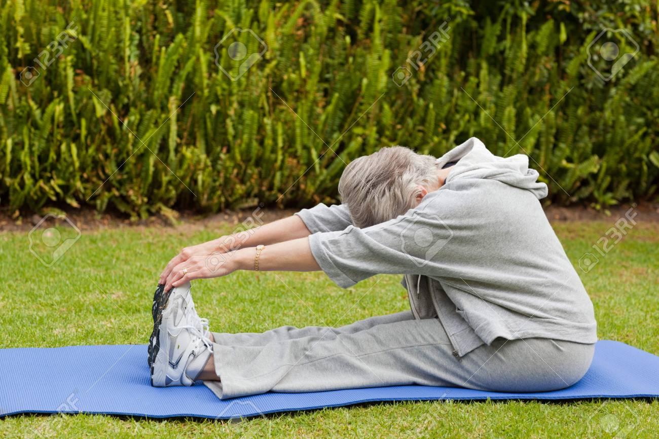 Senior woman doing her streches Stock Photo - 10206424