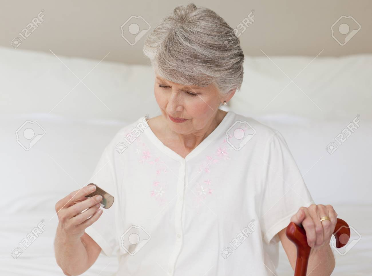 Sick senior woman taking her pills Stock Photo - 10193109