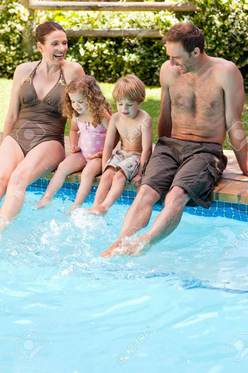 Happy family beside the swimming pool Stock Photo - 10198622