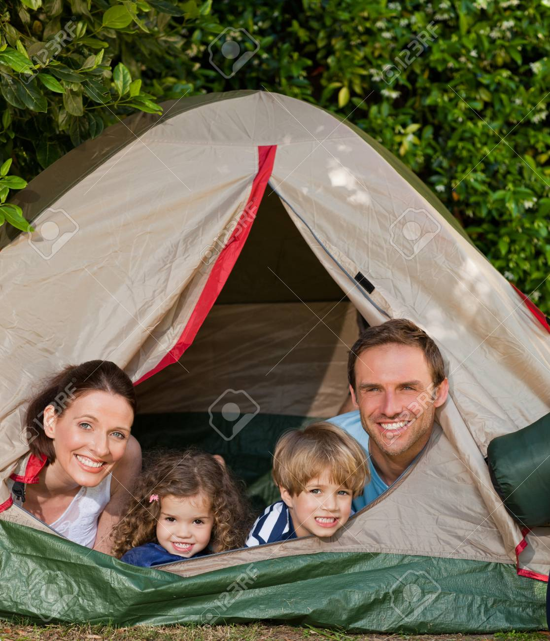Joyful family camping in the garden Stock Photo - 10197648