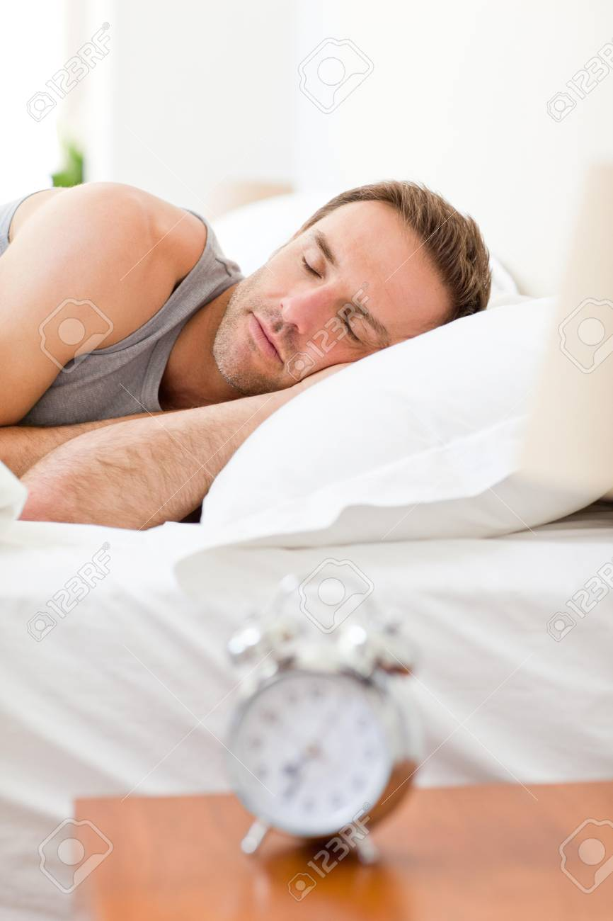 Relaxing man sleeping in his bed Stock Photo - 10193170