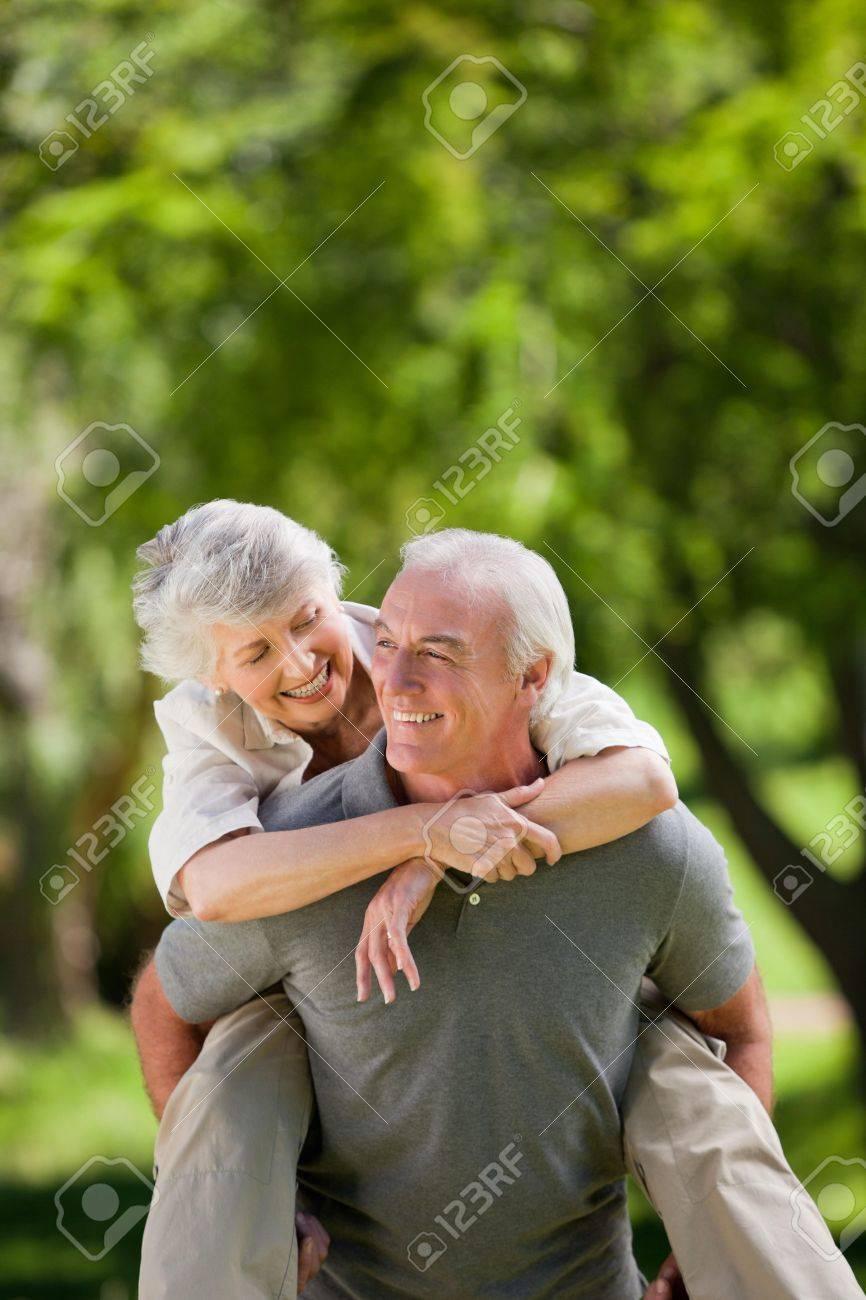 Man giving wife a piggyback Stock Photo - 10197668