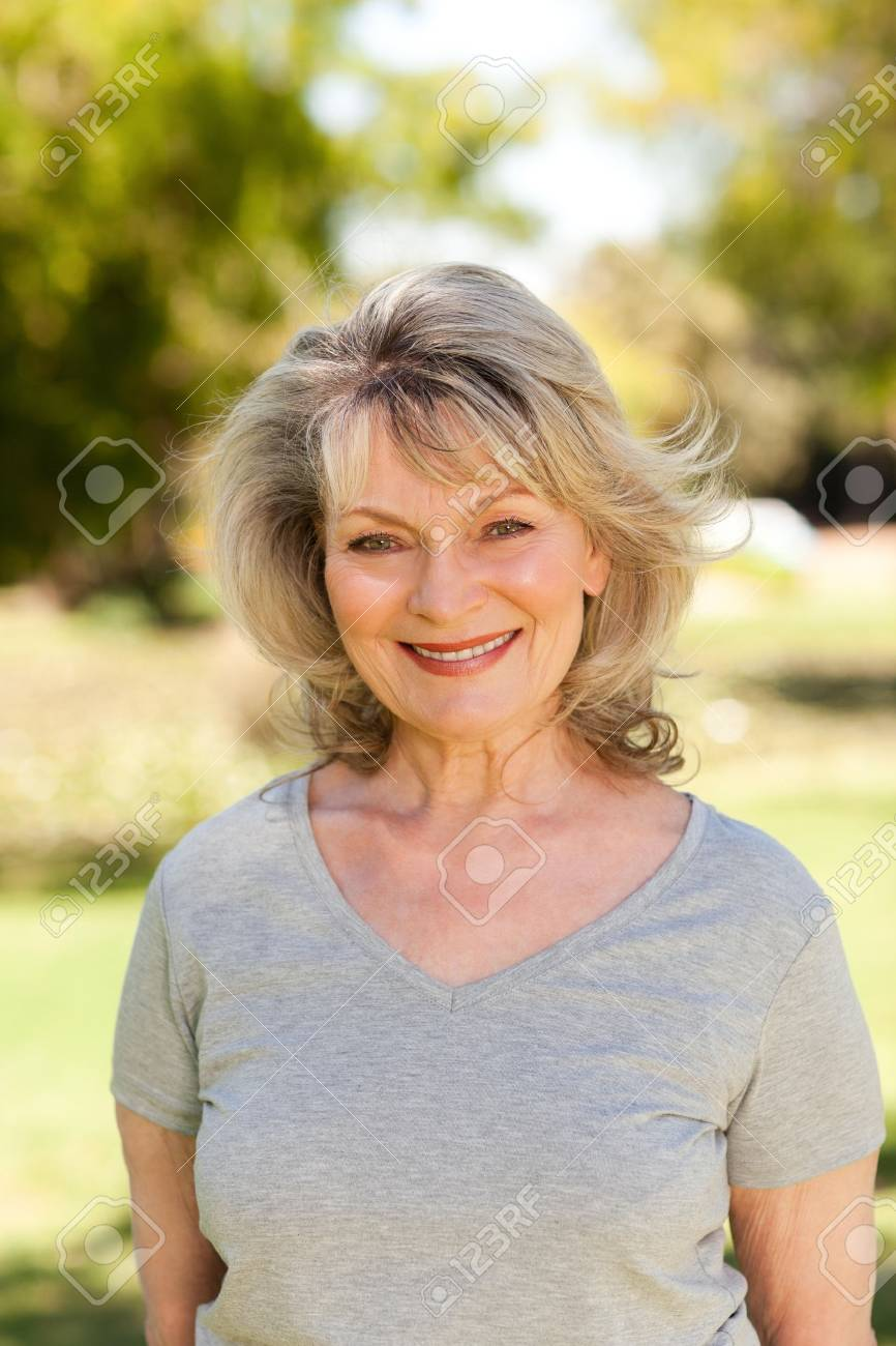 Portrait of a senior woman in the park Stock Photo - 10219259