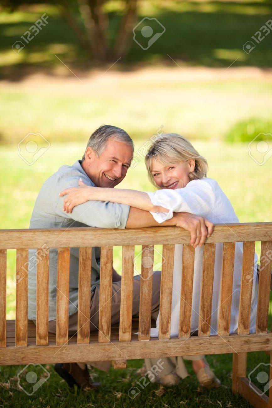 Happy retired couple sitting on the bench Stock Photo - 10218099