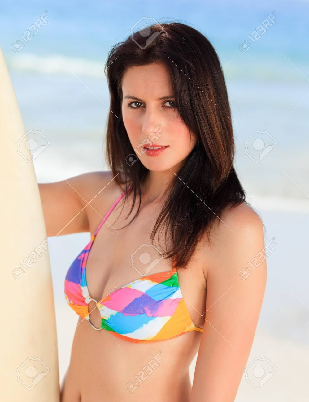 Lovely woman with her surfboard Stock Photo - 10212743