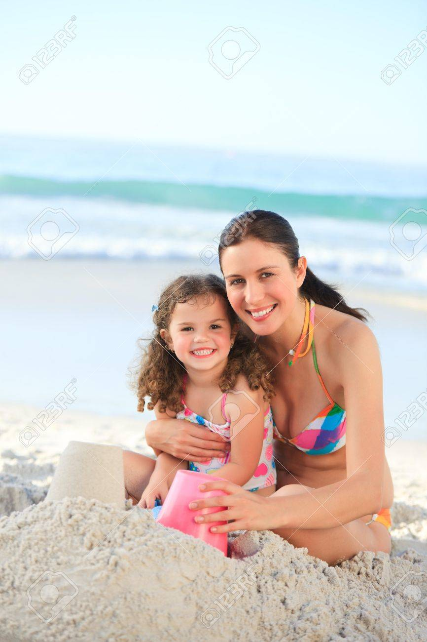 Daughter with her mother making a sand castle Stock Photo - 10214418