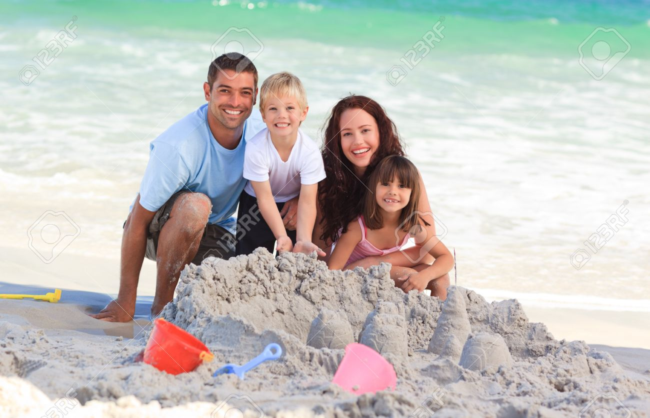 10216177-radiant-family-at-the-beach.jpg