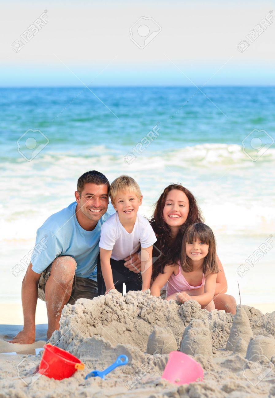 Radiant family at the beach Stock Photo - 10215531