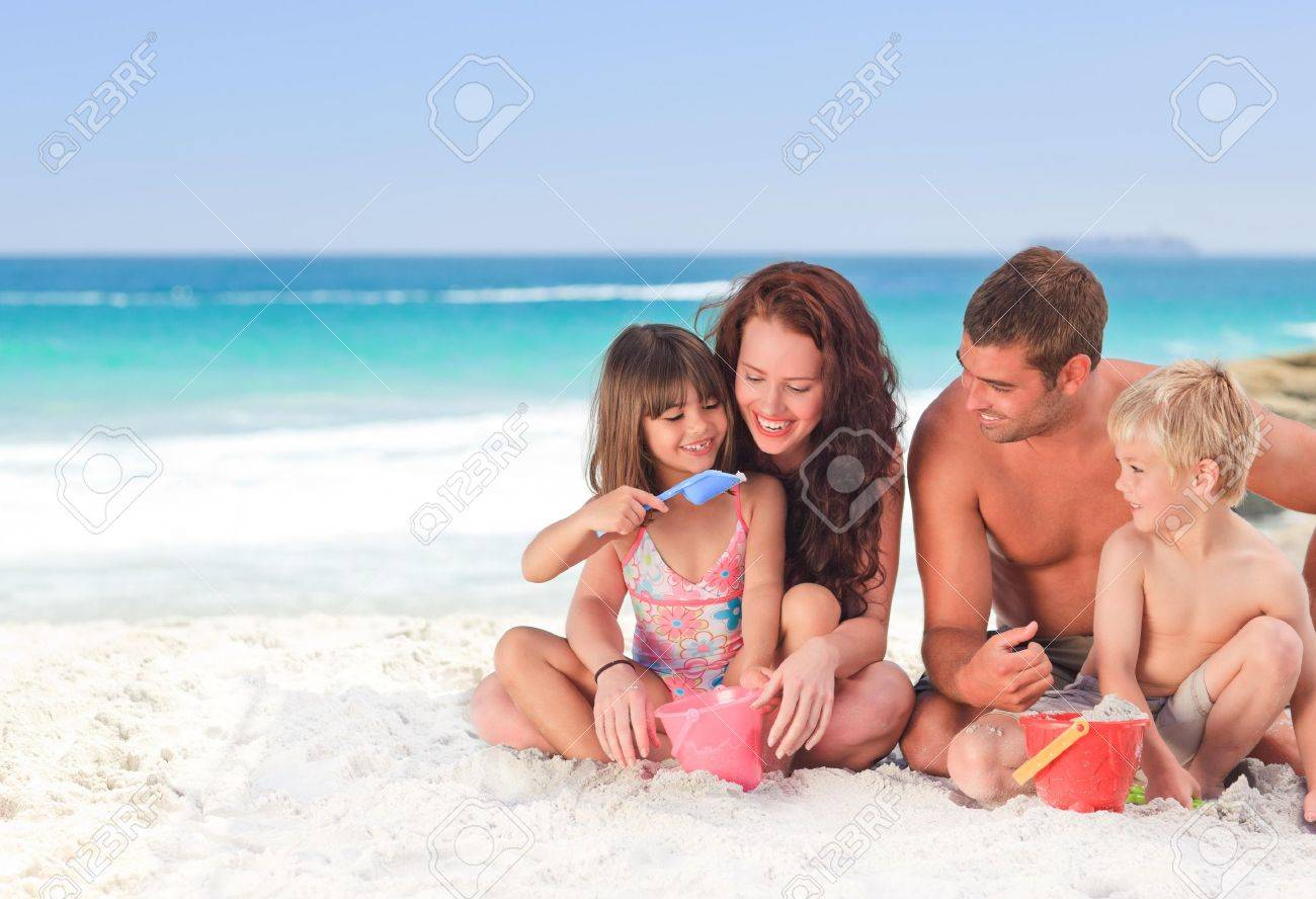 Portrait of a family at the beach - 10214782