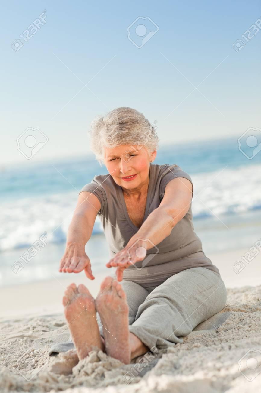 Elderly woman doing her streches Stock Photo - 10215290