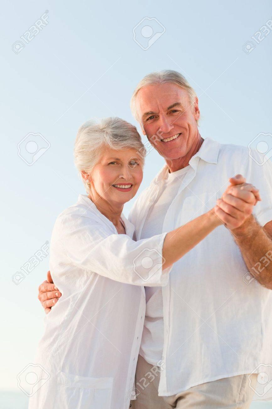 Senior couple dancing on the beach Stock Photo - 10214124