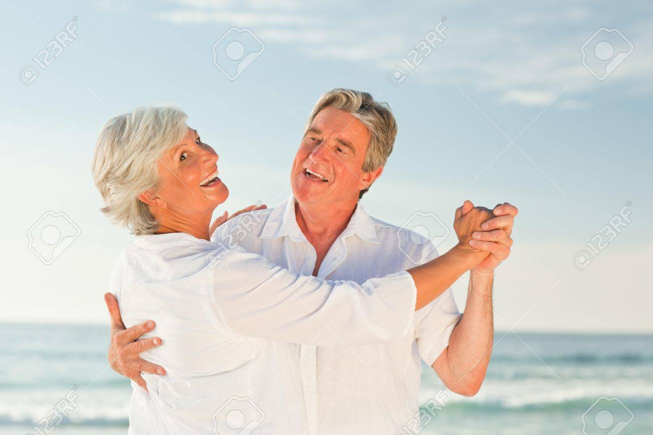 Mature couple dancing on the beach Stock Photo - 10212588