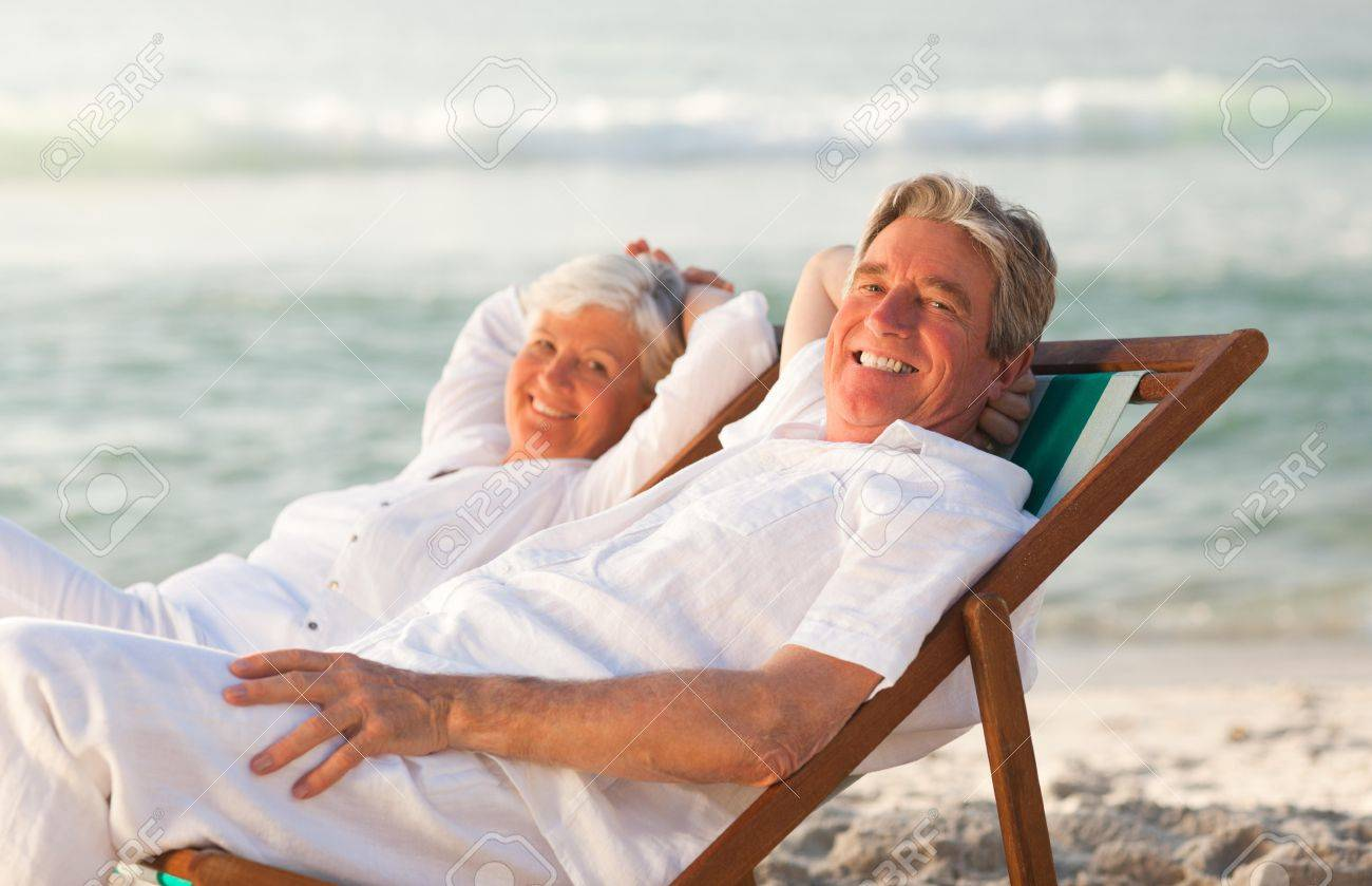 Elderly couple relaxing in their deck chairs Stock Photo - 10212977