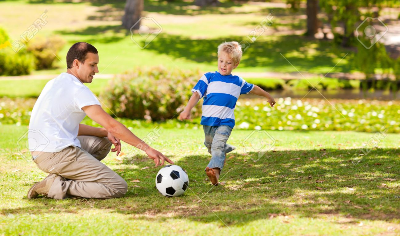 Father playing football with his son Stock Photo - 10218078