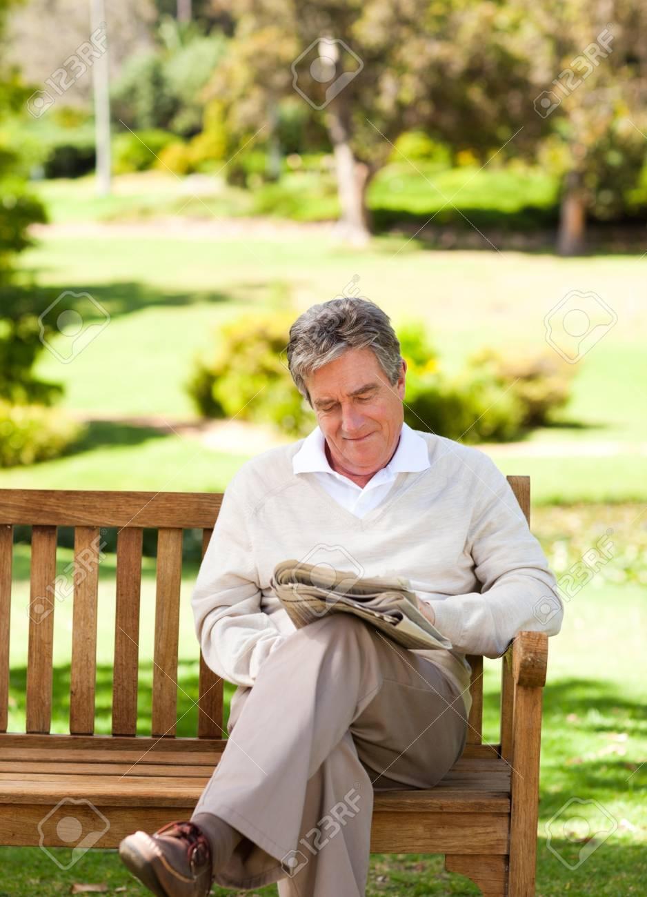 Man reading a newspaper Standard-Bild - 10217391