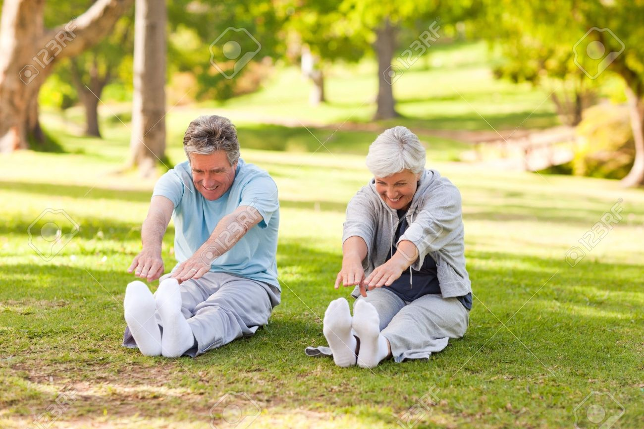 Elderly couple doing their stretches in the park Stock Photo - 10219208