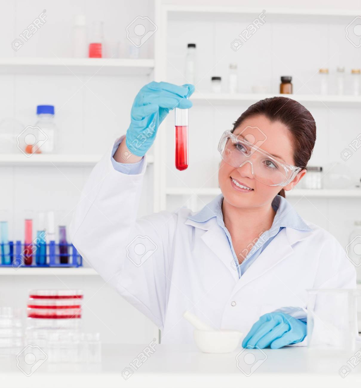 Cute scientist looking at a test tube Stock Photo - 10215374