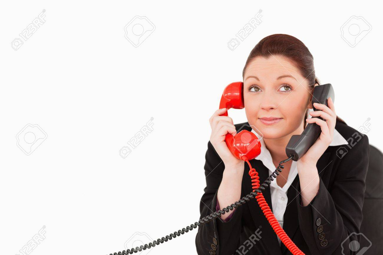 Cute secretary answering two phone calls at the same time against a white background Stock Photo - 10214770