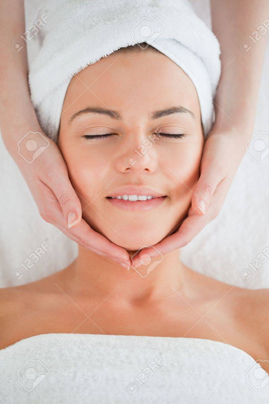 Portrait of a smiling woman having a facial massage closing her eyes Stock Photo - 10229852