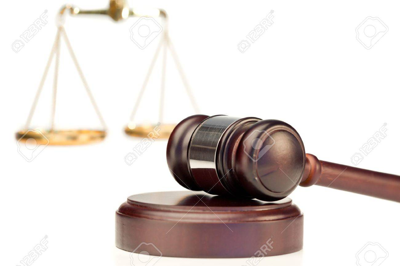 Gavel and scale of justice on a white background Stock Photo - 10231695