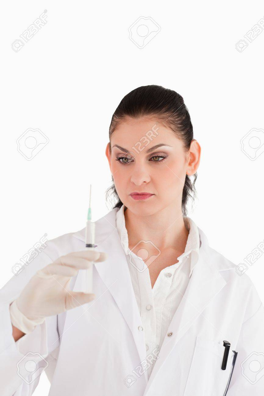 Doctor preparing a syringe on a white background Stock Photo - 10231697